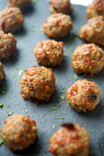 These Cheesy Italian Sausage Meatballs made with sun dried tomatoes, fresh basil, mozzarella and Pecorino Romano cheeses is sure to please the game day snacker in your family.