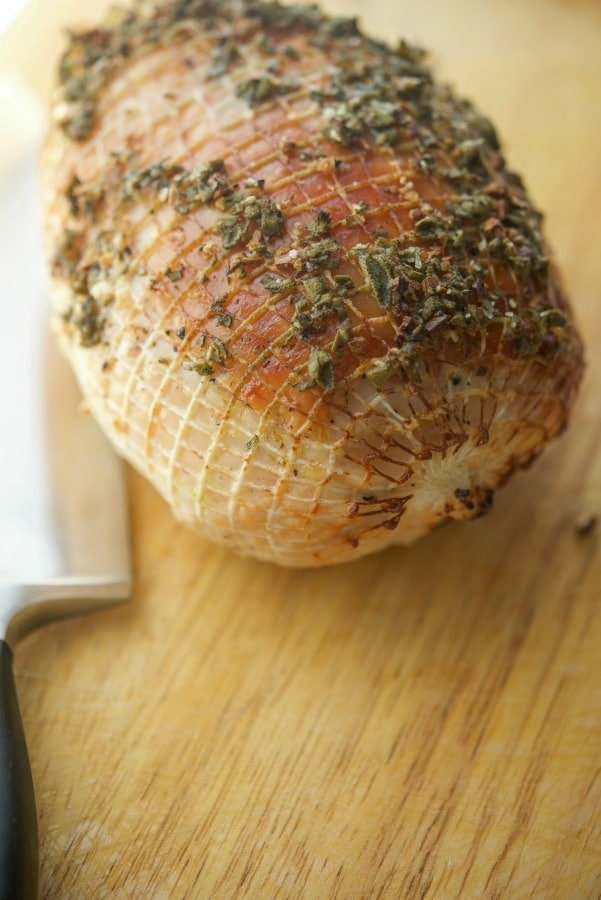 This recipe using fresh sage and minced garlic makes this Garlic & Sage Roasted Boneless Turkey Breast a simple, delicious Fall meal.