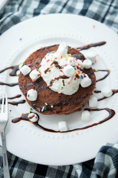 These Hot Chocolate Pancakes made with gluten free Bisquick, chocolate milk, and cocoa powder will make a great start to your morning.