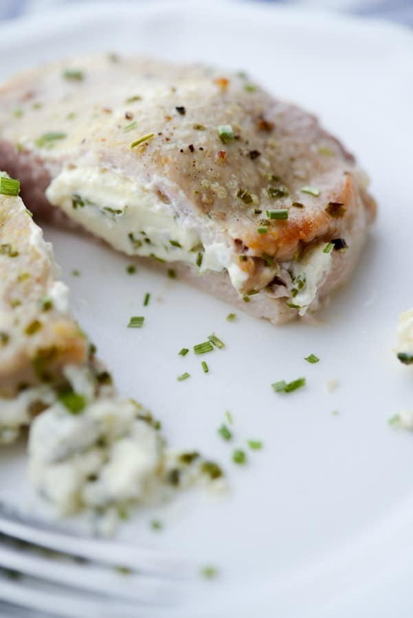 Cream Cheese and Chive Stuffed Pork Chops are a simple to make, quick weeknight meal that is gluten free, low carb and Keto Diet friendly.