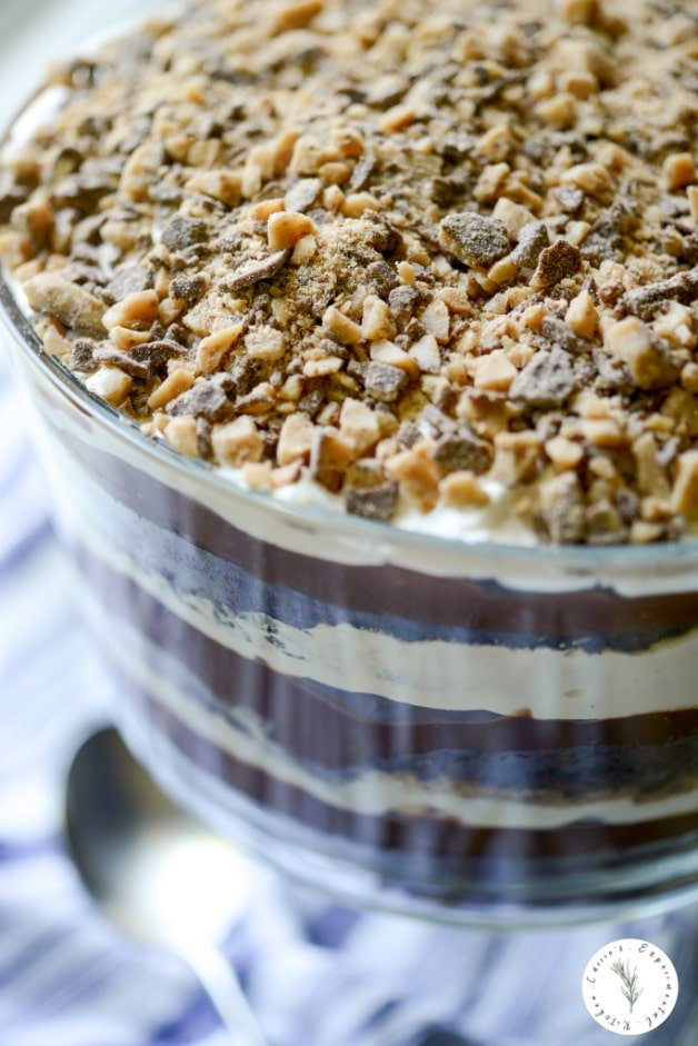 This trifle made with layers of dark chocolate cake, chocolate pudding, cool whip non dairy whipped topping and Heath Bar toffee bits is sinfully delicious.
