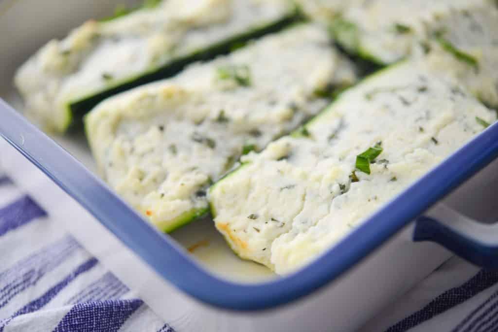 Ricotta, Goat Cheese and Basil Stuffed Zucchini in baking dish