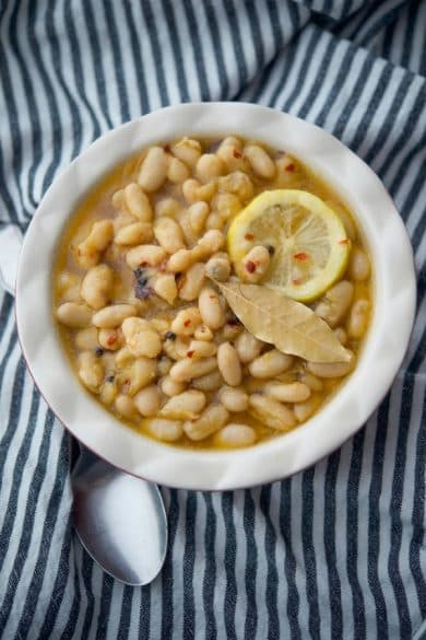 Cannellini beans marinated in EVOO, lemon slices and spices make a tasty, last minute healthy appetizer. A must have addition to any antipasto platter.