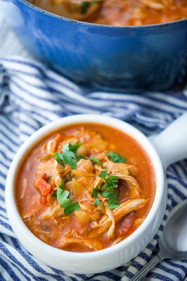 This hearty Mediterranean Roasted Chicken and Chick Pea Soup made with fire roasted tomatoes, artichoke hearts and spices is deliciously filling and perfect for lunch or dinner.