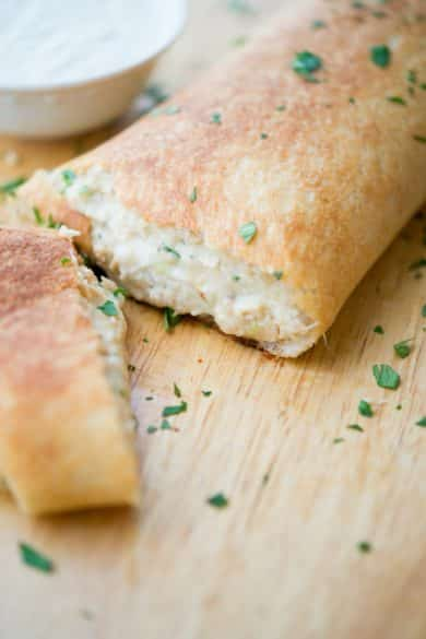 This Buffalo Chicken Stromboli made with pizza dough, shredded chicken, hot sauce, Bleu cheese dressing and Mozzarella cheese is perfect for a quick and easy weeknight meal or game day snack.