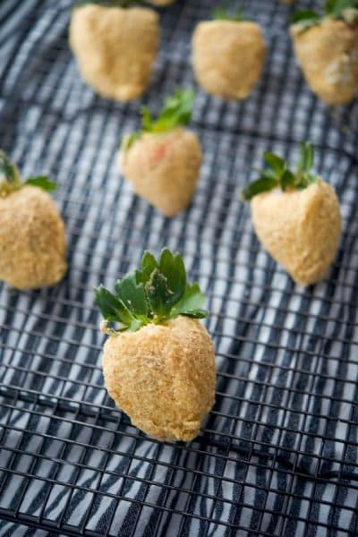 Fresh strawberries coated with sweet cream cheese icing; then dipped in graham cracker crumbs make a tasty after school or holiday treat.