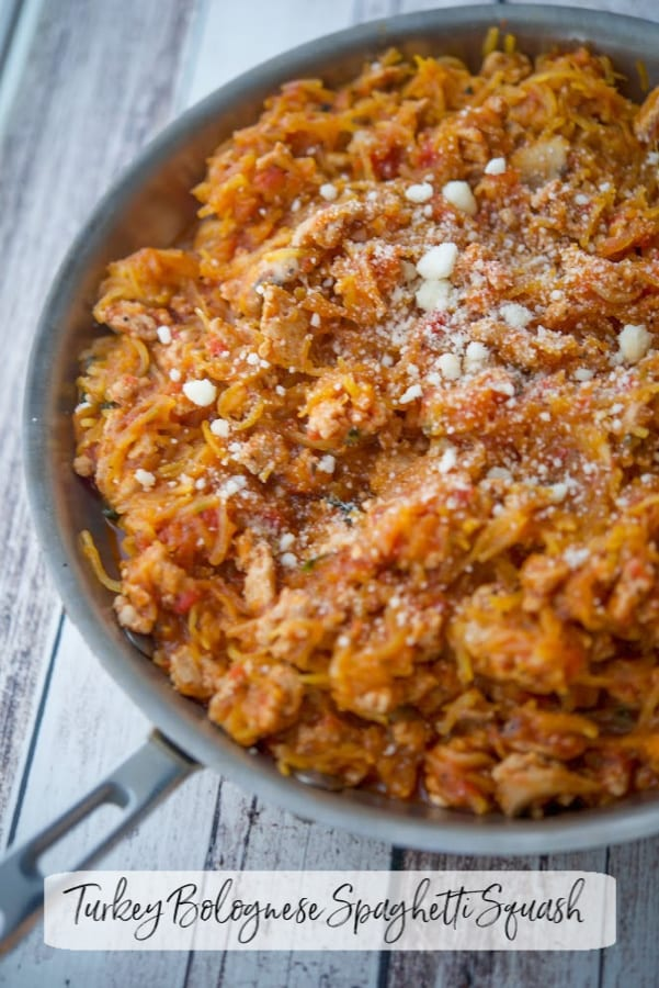 Oven roasted spaghetti squash tossed with an Italian bolognese sauce made with ground turkey, mushrooms, garlic and oregano is a deliciously, easy, healthy dinner alternative.
