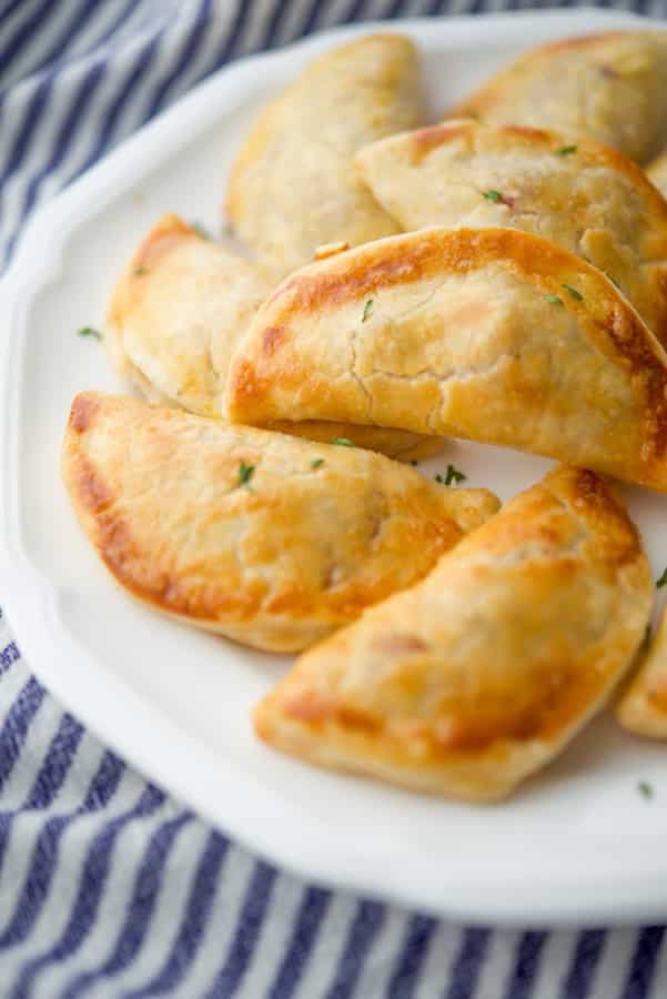 Empanadas stuffed with Portuguese chorizo, ground beef, spices and a creamy lemony sauce ; then baked until golden brown.