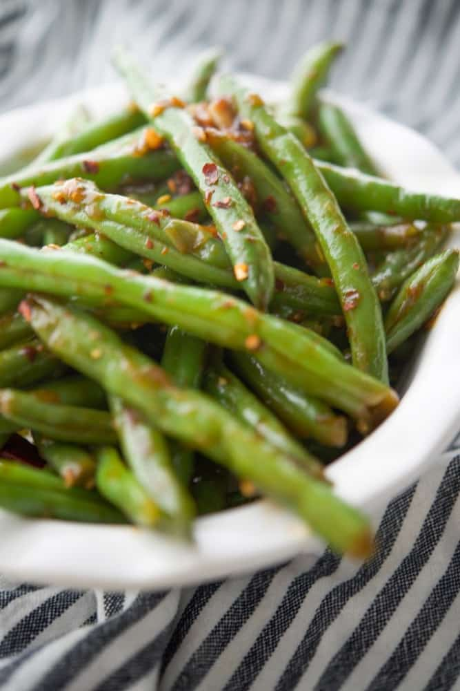 Chili Garlic Green Beans with an Asian flare are one of PF Changs most popular side dishes. Now you can make these tasty vegetables at home!
