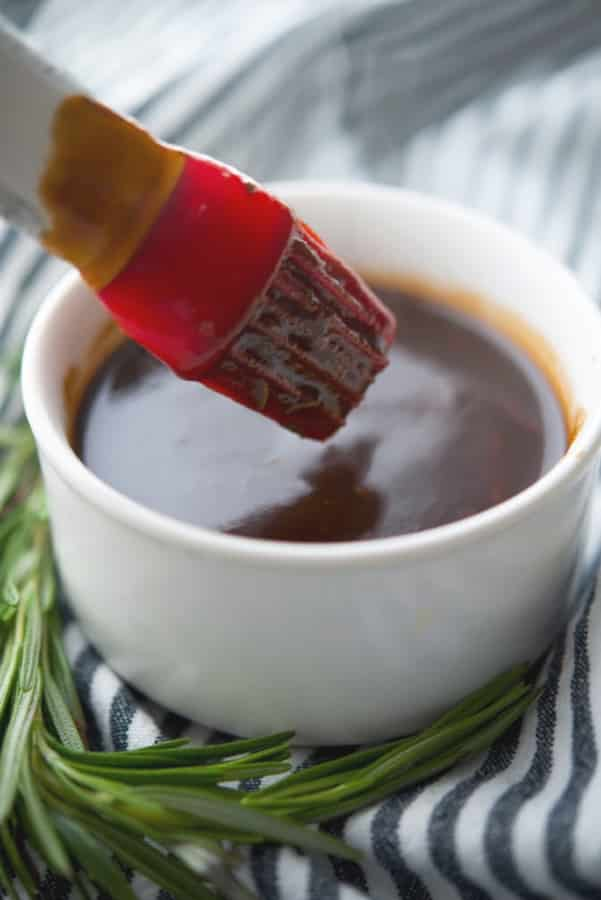 This BBQ sauce made with balsamic vinegar, brown sugar, ketchup, garlic, mustard and fresh rosemary tastes great on grilled chicken, beef or pork.