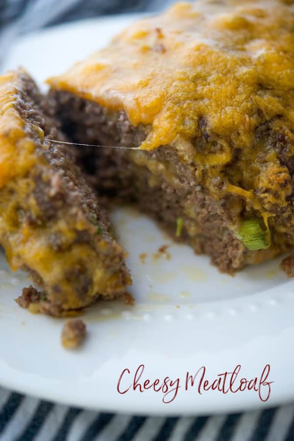 This meatloaf made with lean ground beef, shredded Cheddar cheese, and Panko breadcrumbs is super cheesy, moist and delicious!