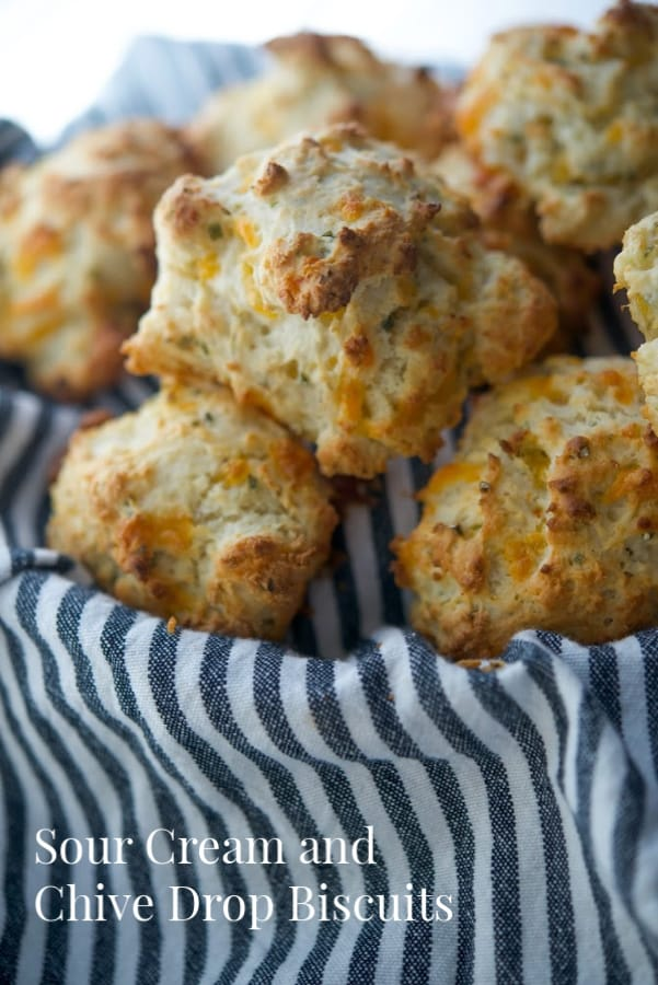 These flaky Sour Cream and Chive Drop Biscuits are so deliciously light and buttery, you'll never make homemade yeast rolls again!