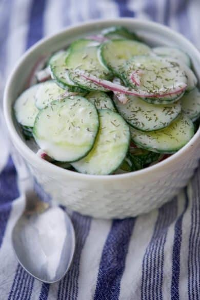 Old Fashioned Cucumber Salad is a creamy, mayo based, slightly tart salad that is perfect for those Summer cookouts or game day parties.