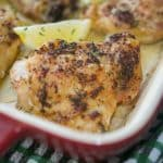 Rosemary & Lemon Roasted Chicken Thighs in red baking dish.