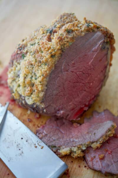 Top round roast beef encrusted with a mixture of Parmesan cheese, fresh parsley, garlic and panko breadcrumbs is an easy way to add extra flavor to your family meal.