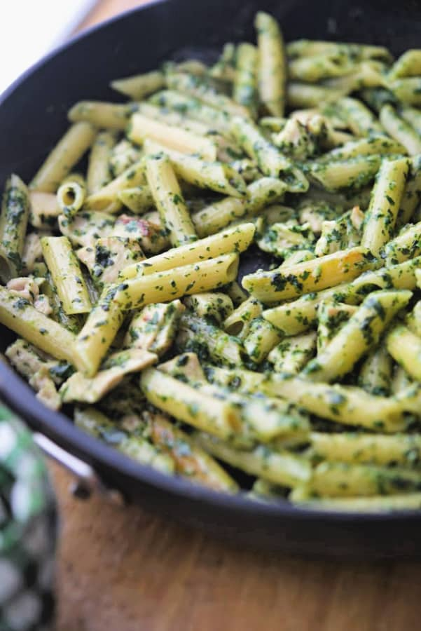 Penne pasta combined with boneless chicken in a homemade pesto sauce; then cooked on top of the stove in a skillet is a quick and easy weeknight meal.