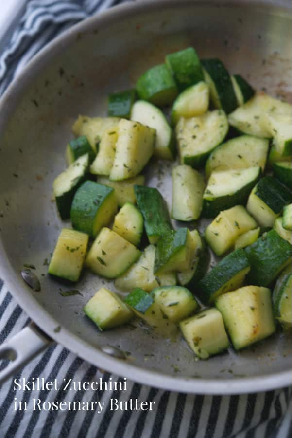 Fresh garden zucchini squash sautéed in a skillet on top of the stove in rosemary butter is a tasty, quick side dish that goes well with so many main entrees.