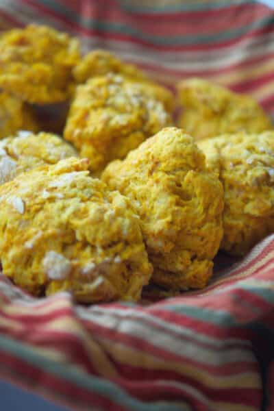These flaky Pumpkin Drop Biscuits are so deliciously light and buttery, you'll never make homemade yeast rolls again!