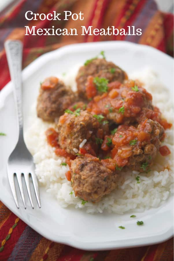 Mexican Meatballs made with ground beef, taco seasoning, pico de gallo and cheese are cooked in the crock pot for tasty weeknight dinner.