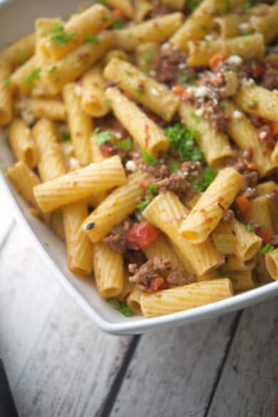 Rigatoni pasta tossed with a mirepoix of vegetables and spices in a fire roasted tomato meat sauce makes the perfect quick, weeknight meal.