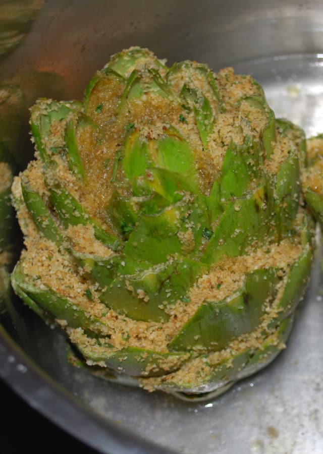 Whole artichokes stuffed with Italian seasoned breadcrumbs, grated Pecorino Romano cheese, spices and olive oil.