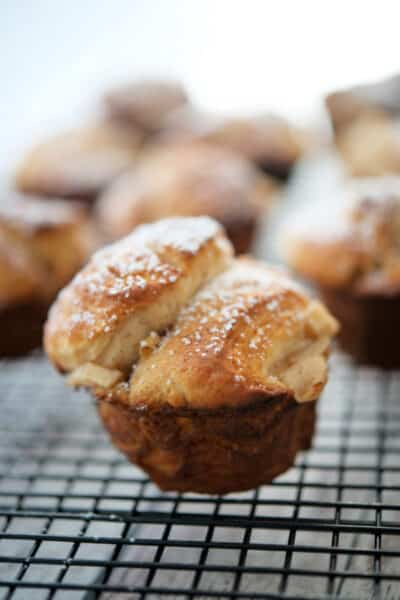 Monkey bread rolls made with fresh chopped apples, brown sugar, ground cinnamon and chopped walnuts make a tasty, sweet snack.
