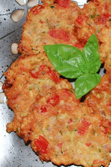 Greek Tomato Zucchini Fritters made with tomatoes, zucchini, fresh mint, basil and self rising flour, make a tasty side dish