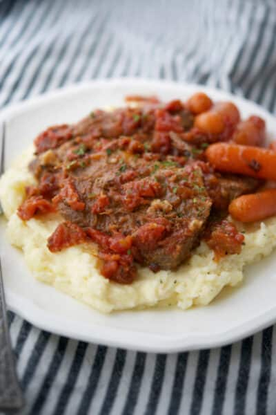 Italian Style Beef Brisket on top of mashed potatoes