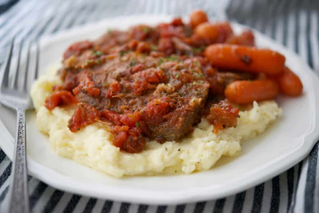 Italian Style Beef Brisket with carrots and mashed potatoes.