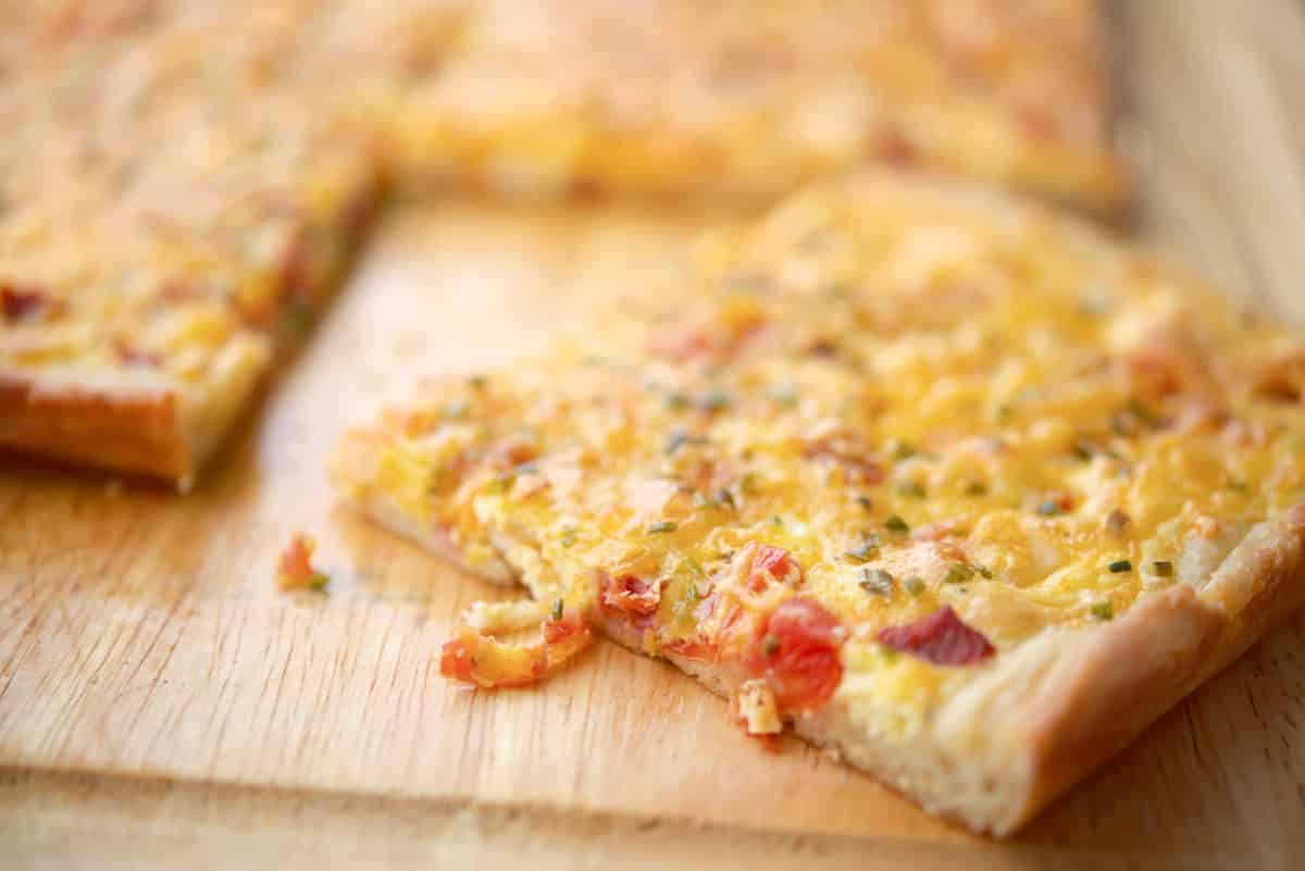Portuguese Breakfast Pizza with chourico, eggs and potatoes.