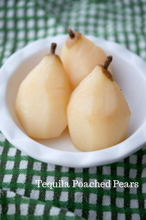 Bosc pears slowly poached in a crock pot with tequila, pear nectar, sugar and lime juice makes a tasty adult treat!