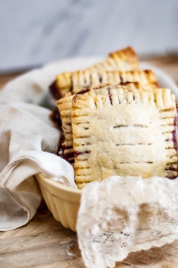 Mixed Berry Hand Pies vertical image in a basket