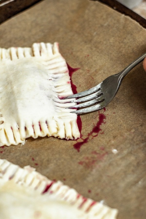 Mixed Berry Hand Pies before cooking with a fork