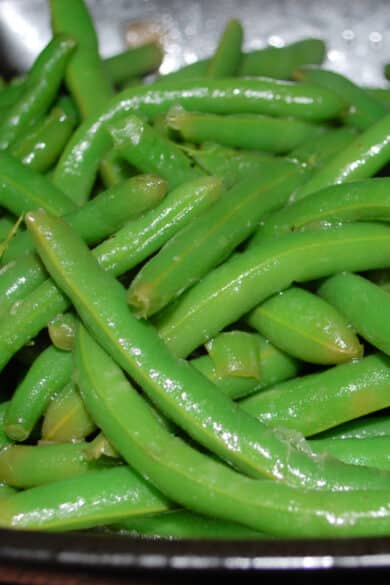 Fresh green beans steamed; then sautéed with butter, chicken and beef broth, Kosher salt and black pepper will be your new favorite vegetable.