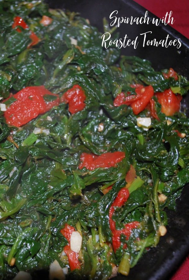 Spinach sautéed with roasted plum tomatoes, garlic and Extra Virgin Olive Oil makes a tasty vegetable side dish to any meal.