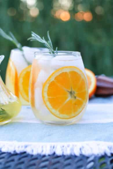 This spritzer made with Italian Limoncello, vodka, champagne and a rosemary simple syrup is deliciously light and refreshing.