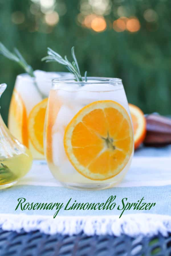 Rosemary Limoncello Spritzer in a glass with orange slice.