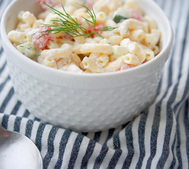 Dill Macaroni Salad made with English cucumbers, tomatoes and a sour cream and fresh dill dressing is super tasty.